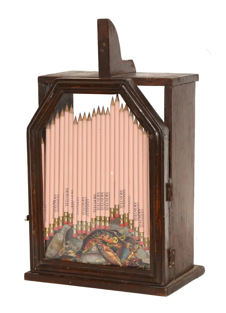 Artist: Arman Title: Wooden box with Pencils  Year: Mid-Late 20th Century Medium: Mixed media, signature etched into glass Size: 13 x 9 x 6.5 inches