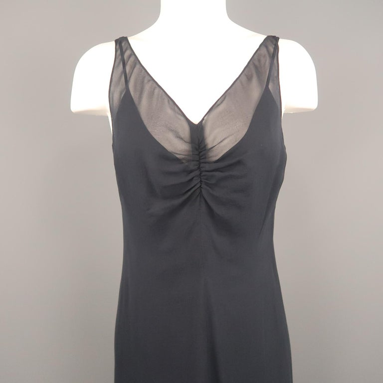 ARMAND VENTILO sleeveless maxi dress comes in navy silk chiffon with a deep V neckline, gathered front, A line silhouette and buttoned back. With slip.   Excellent Pre-Owned Condition. Marked: IT 38   Measurements:   Bust: 36 in. Waist: 32 in. Hip: