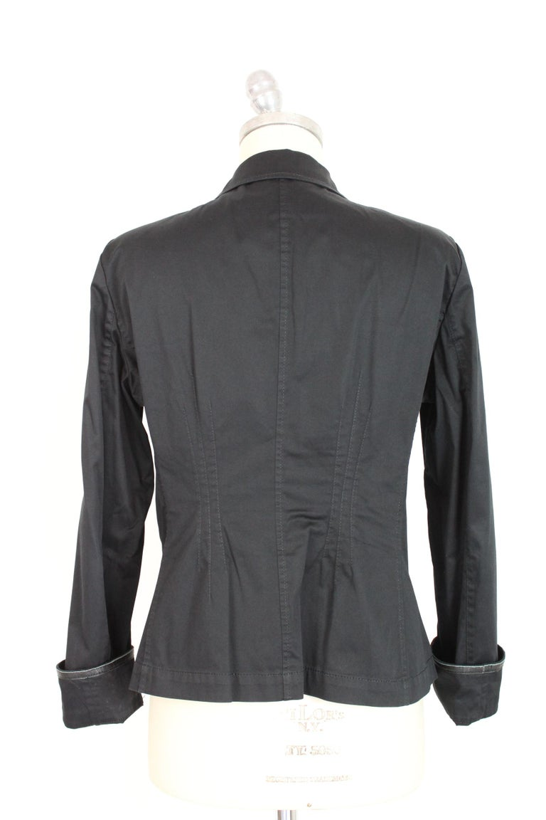 Armani Collezioni 90s vintage women's jacket. Flared jacket, black color, 96% cotton 4% elastene. Leather details on the pockets and cuffs of the sleeves. Made in Italy. Excellent vintage conditions.  Size: 46 It 12 Us 14 Uk  Shoulder: 46 cm  Bust /