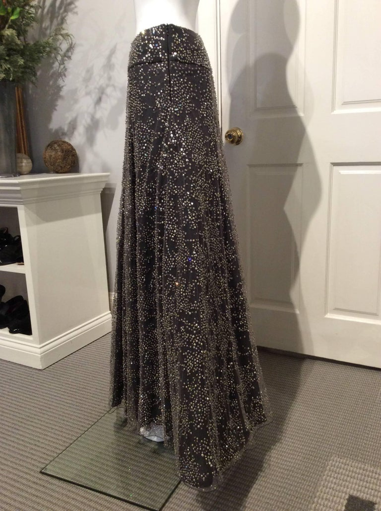 "Limited edition Armani black label long dark grey tulle skirt with pewter colored crystal embroidery with a black silk lining over a black caged stiff petticoat. 7.5"" side zipper. This garment is brand new with the Bergdorf Goodman price tag of"