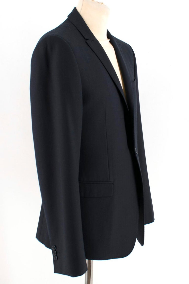Armani Collezioni Navy Blue Blazer Jacket  Blue single breasted blazer jacket, Long sleeves, Front flap pockets, Front chest welt pocket, Padded shoulders,  Standard notch lapel collar, Single back vent, Button up cuffs   Please note, these items