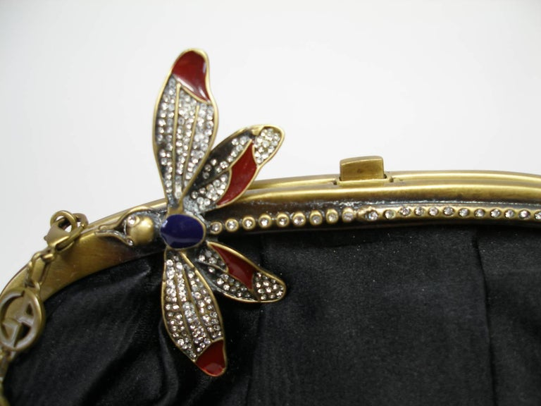 So cute ! RARE Evening Bag or Evening Clutch Emporio Armani Satin and butterfly décoration in rhinestones  Please note for this purchase : some missing rhinestones on the butterfly Black color  Small size   Approximate measures L 25 X H 14 X 3