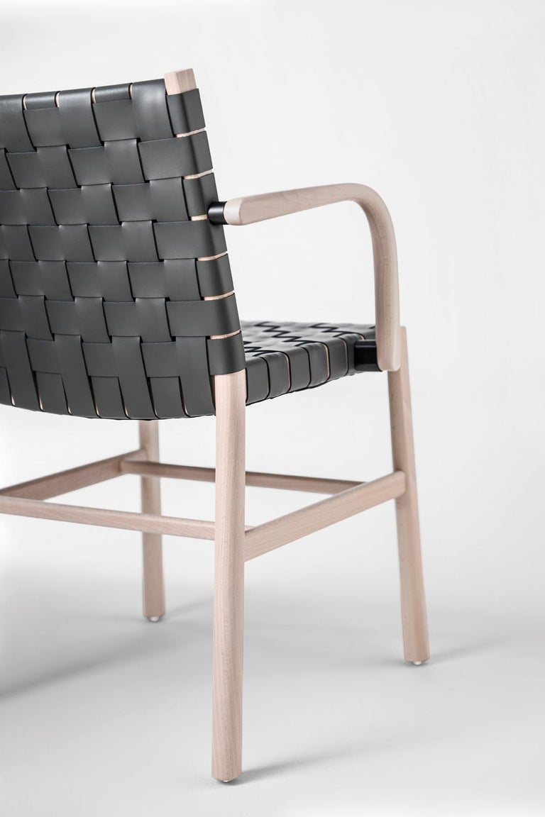 Julie Collection expands to include a new model featuring a backrest and seat with a interwoven thick leather. The frame in beechwood will be painted or lacquered in different colors , the thick leather available in 20 colors. Ideal for contract