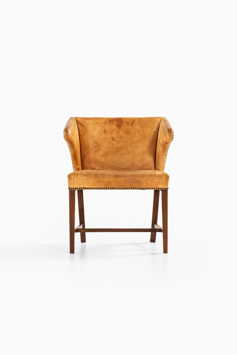 Very rare armchair attributed to Frits Henningsen. Produced by cabinetmaker Frits Henningsen in Denmark.