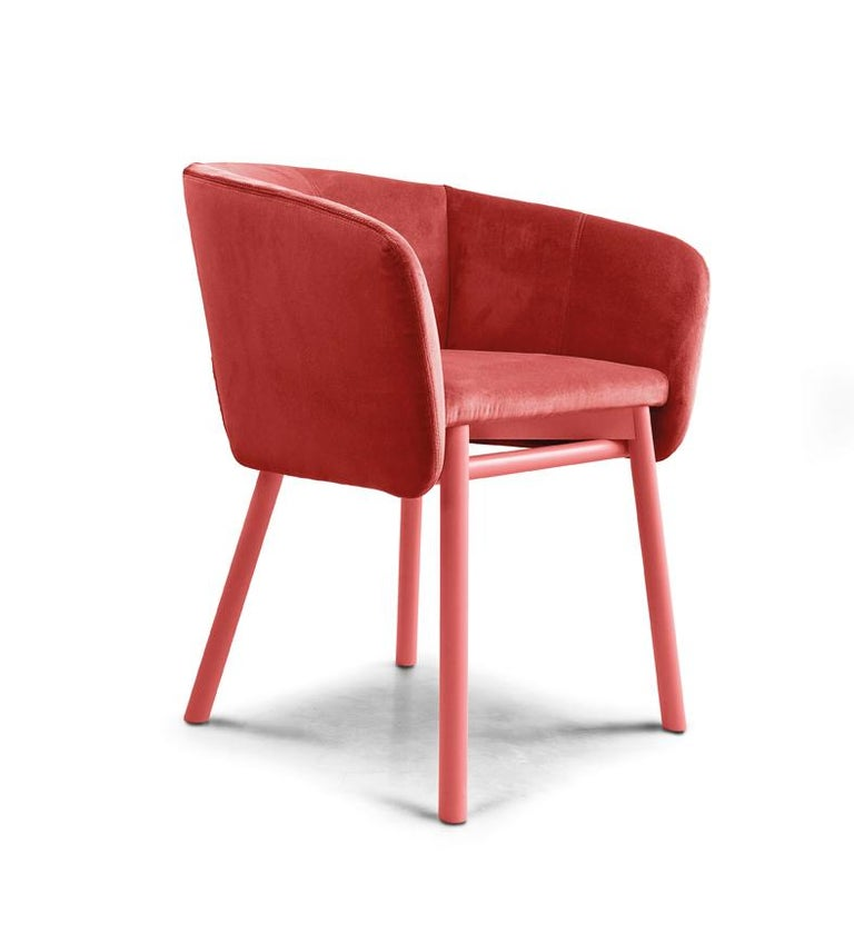 """The deep, rounded seat encourages relaxation and conversation. The perfectly balanced volume of the body matches impeccably with the characteristic support frame, thus redefining the typical """"tub"""" chair. The internal plywood body and the"""
