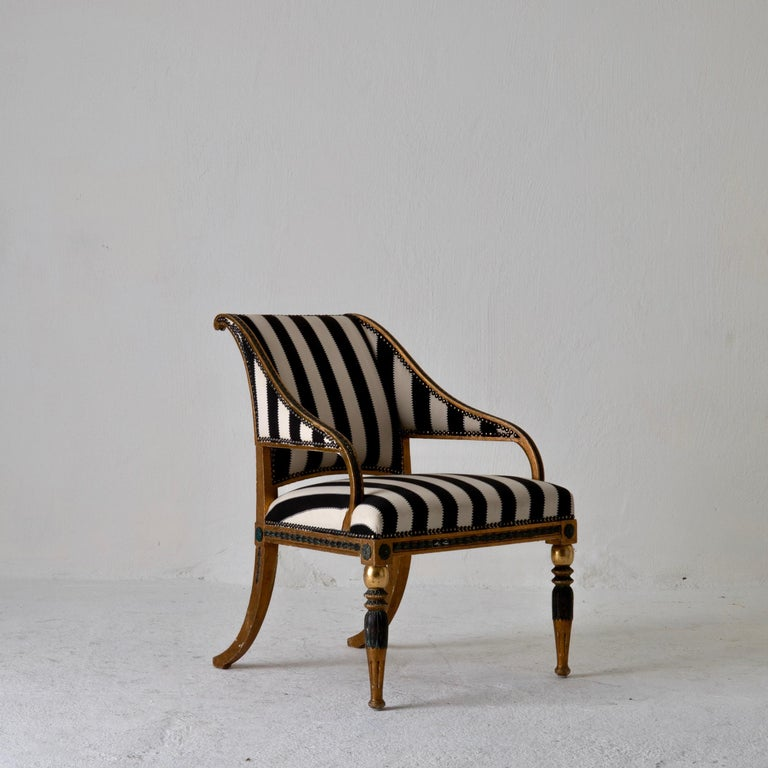 An armchair made during the 18th century in Sweden. Attributed to the royal chair maker Ephraim Stahl. Gilt wood with green details. Upholstered in a Pierre Frey.