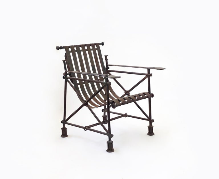 Brutalist armchair in forged iron by artist Ilana Goor, with original patina and signed plaque on the bottom stretcher.