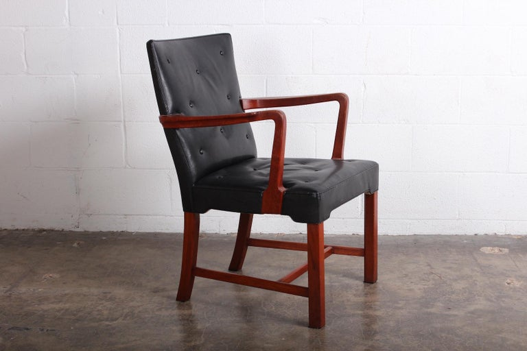 A teak and leather armchair or desk chair by Jacob Kjær.