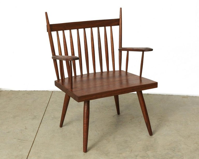 Chair with armrests by Michael Rozell, USA, 2021. The chair has a slightly tapered back atop of thin spindles.