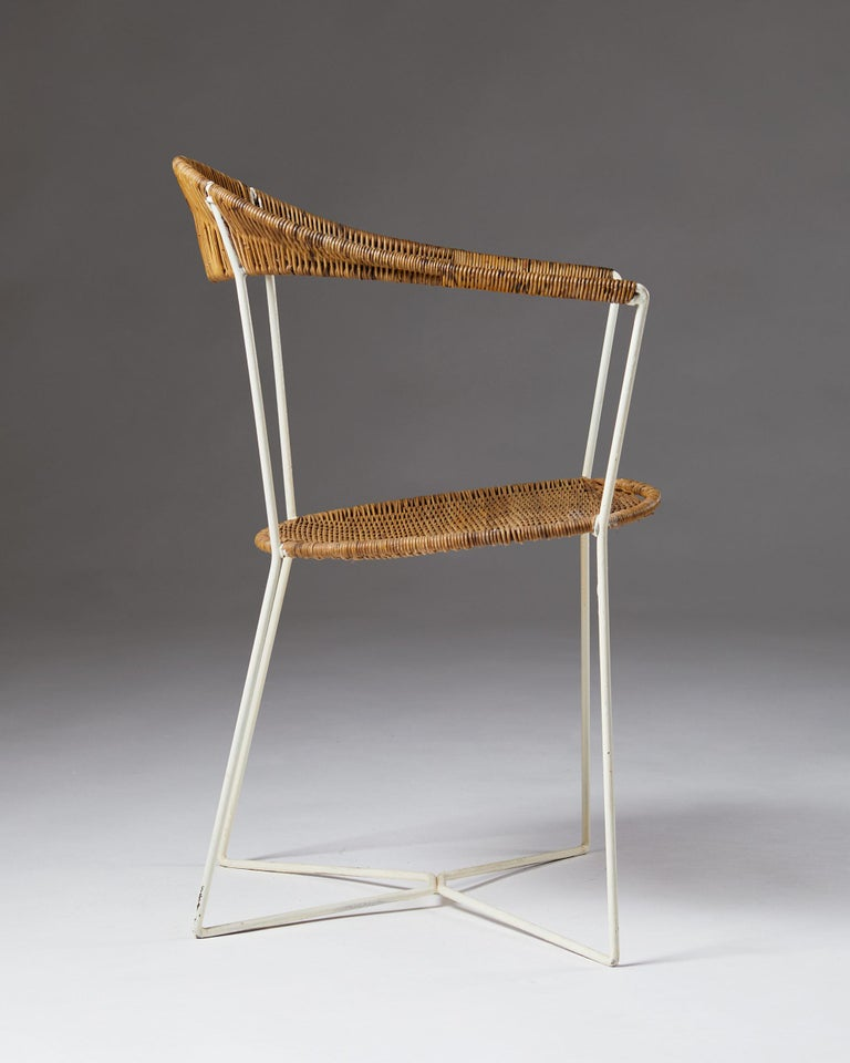 Armchair designed by Ivar Callmander Sweden, 1920s. Lacquered steel and cane.  Measures: H 82 cm / 2' 8 1/4