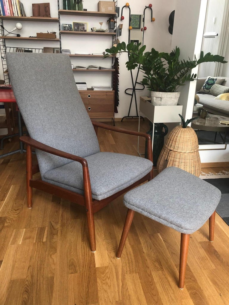 Danish high-back armchair by Svend Langkilde for SL Mobler, upholstered and newly upholstered with wool fabric. Very comfortable, with high backrest and matching footrest. The seating position can be adjusted in 2 steps. Solid teak, beautiful shape.