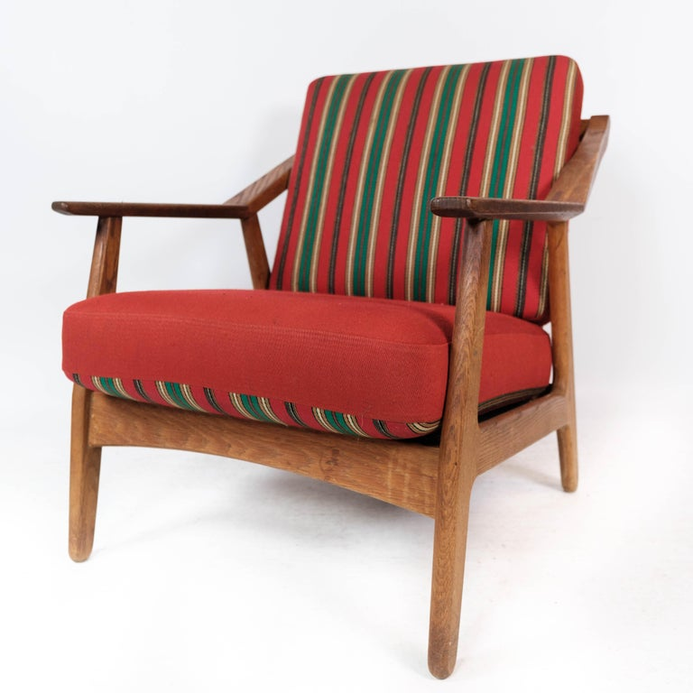 Scandinavian Modern Armchair in Oak and Upholstered with Red Fabric, by H. Brockmann Petersen, 1960s For Sale