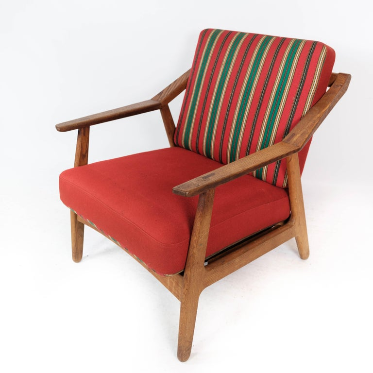 Danish Armchair in Oak and Upholstered with Red Fabric, by H. Brockmann Petersen, 1960s For Sale
