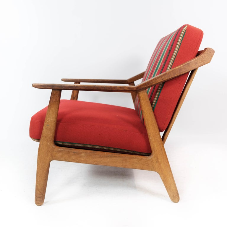 Mid-20th Century Armchair in Oak and Upholstered with Red Fabric, by H. Brockmann Petersen, 1960s For Sale