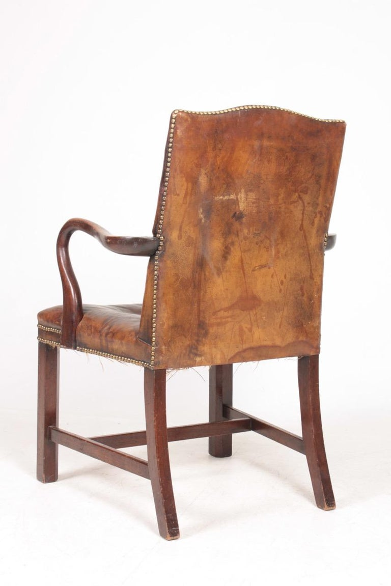 Mid-20th Century Armchair in Patinated Leather, Danish Design, 1940s For Sale