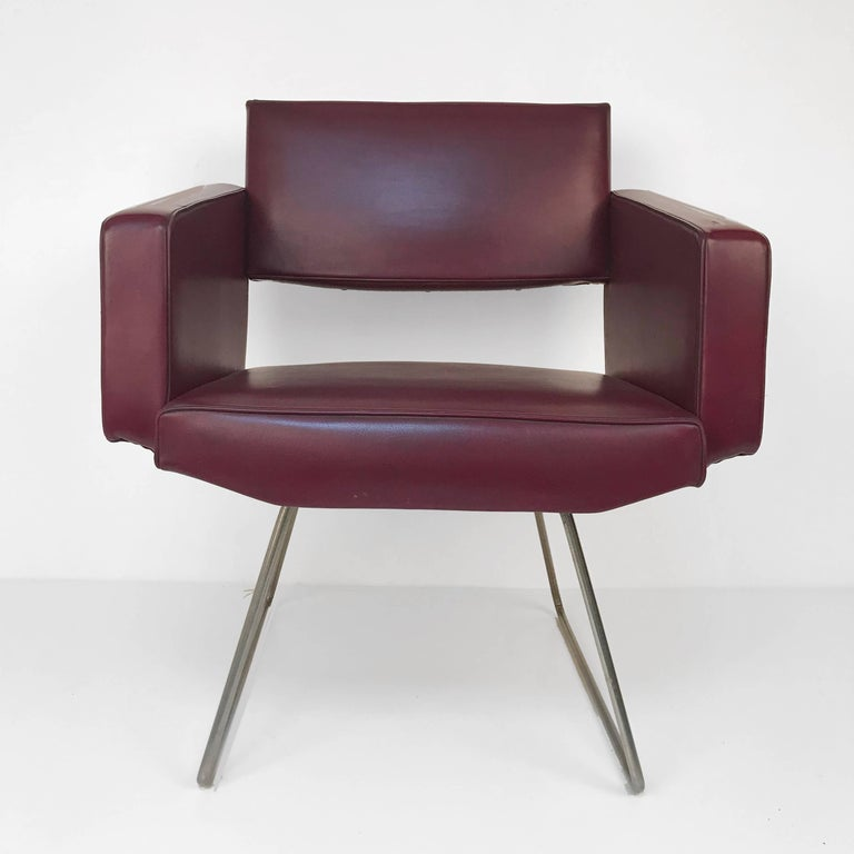 Armchair in the style of Joseph Andre Motte, France, 1950s. Beautiful with sled legs in bordeaux faux leather.