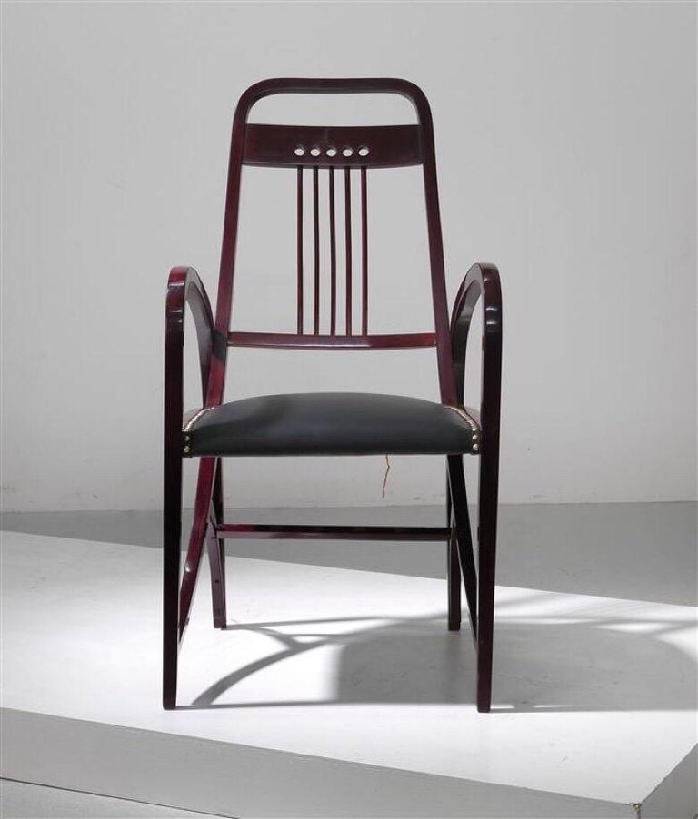 Armchair model 511, manufactured by Gebrüder Thonet Vienna, circa 1904, four-legged design, square-cutwood, black-brown stained, renewed seat with decorative nails. Dimensions height about 105 cm, width about 55 cm, depth about 60 cm.