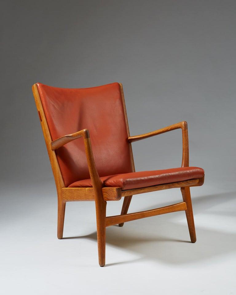 Armchair model AP16 designed by Hans Wegner for AP stolen oak and leather.
