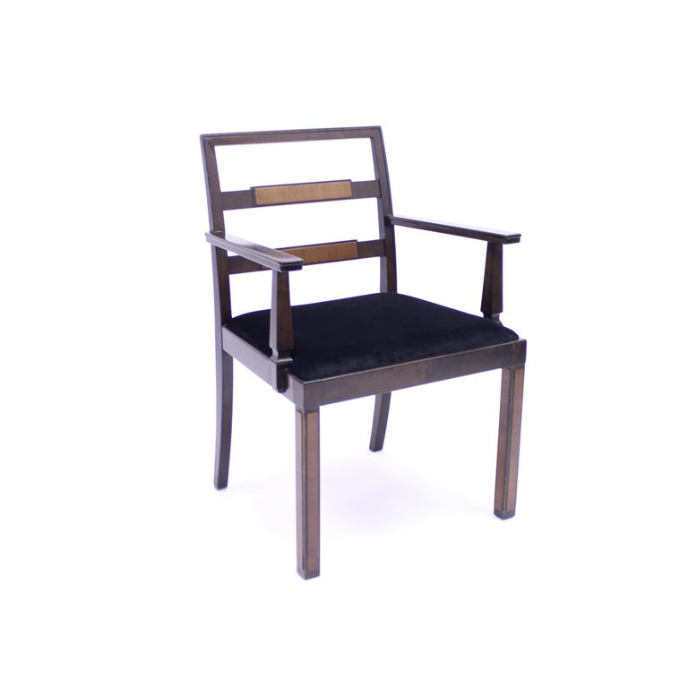 Armchair, model Empire, attributed to Axel Einar Hjorth, manufactured by Nordiska Kompaniet. Produced in 1934. Stained Birch frame with Walnut inlays on the backrest and legs. New black velvet upholstery on the seat  This model is recorded in the