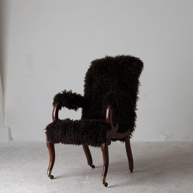 Armchair Sweden late 19th century brown Swedish. A chair made during the later part of the 19th century. Reupholstered in a chocolate brown long haired fur. Frame made in mahogany and legs ending in brass casters.