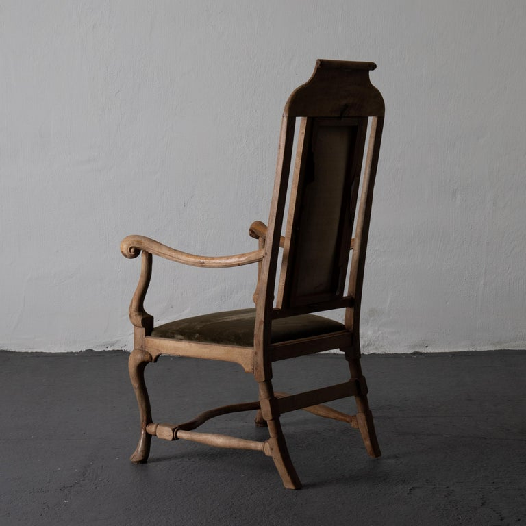 Armchair Swedish Baroque wood green velvet Sweden. An armchair made during the Baroque period in Sweden. A raw wooden frame with beautiful carvings. Upholstered in a slightly faded green velvet.