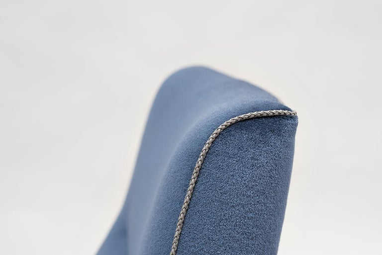 This Bauhaus or International style chair by GHYCZY is comfortable, yet elegant. The frame of the armchair is made of curved stainless steel mirror polished tubes. The seat is ergonomic and is made of a soft comfortable blue natural mohair fabric