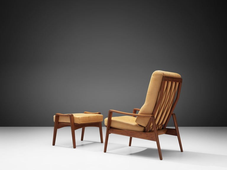 Arne Wahl Iversen, lounge chair with ottoman, with original leather and teak, Europa, 1960s.  The frame of these armchairs is made out of teak. The seats are covered in their original tan leather, contrasting the frame. The combination of these