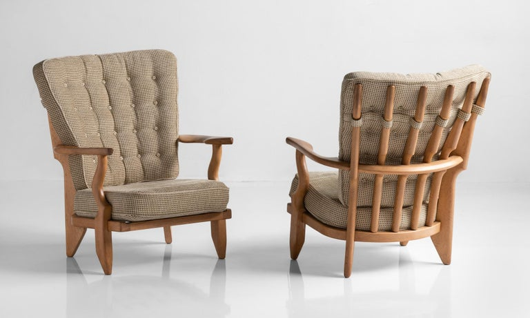 Armchairs by Guillerme & Chambron, France, circa 1950  Carved oak frame with original upholstered seat and back.