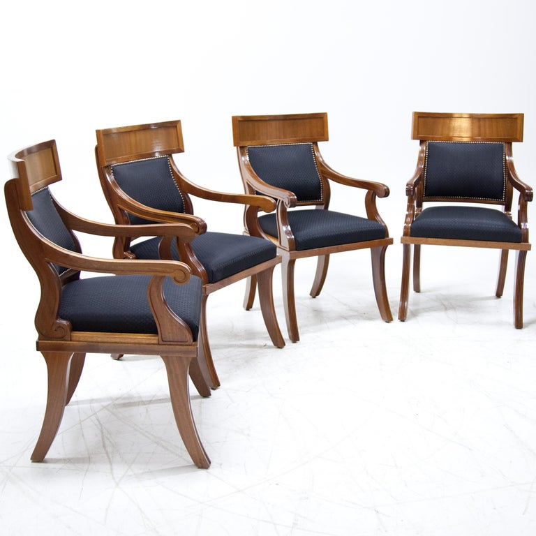 Set of six armchairs in late Biedermeier style with upholstered seat and backrest. These were newly covered with a dark blue fabric with a diamond pattern, the backrest was additionally decorated with rivets.