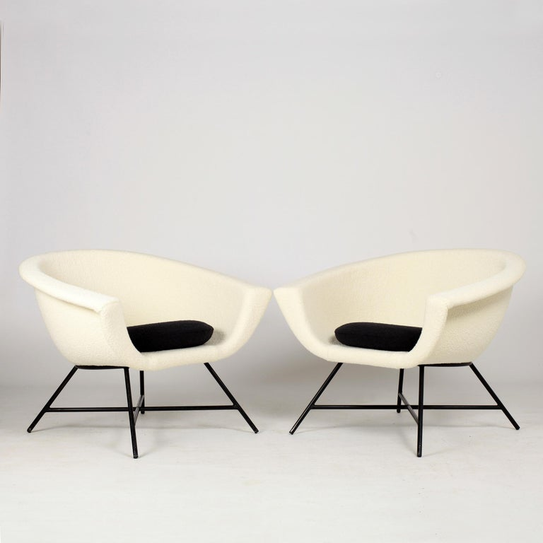 Beautiful pair of armchairs model 58 first edition by Genevieve Dangles and Christian Defrance. The chairs have a black lacquered metal base and fiberglass shell newly upholstered in Pierre Frey and Dedar fabric. References :