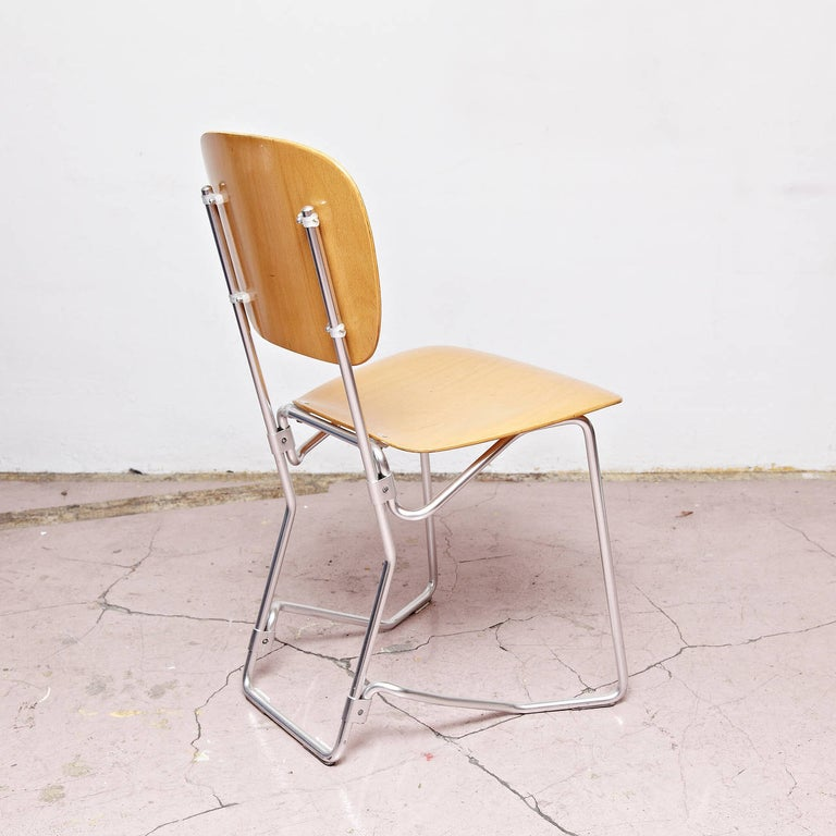 Stackable Aluflex chairs designed by Armin Wirth.