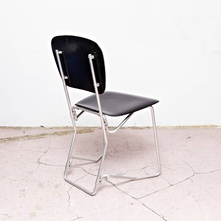 Stackable Aluflex chairs designed by Armin Wirth