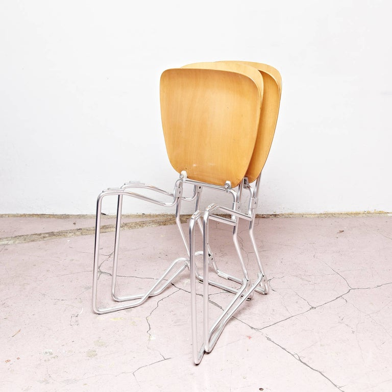 Mid-20th Century Armin Wirth Mid-Century Modern Metal and Wood Swiss Stackable Chairs for Aluflex For Sale