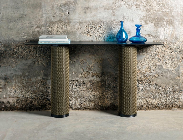 The Armor console table, inspired by the intricate use of chainmail in Medieval Armor, features a cold-rolled steel table cloaked with finished stainless steel chainmail. The console table is the newest addition to our Armor collection.