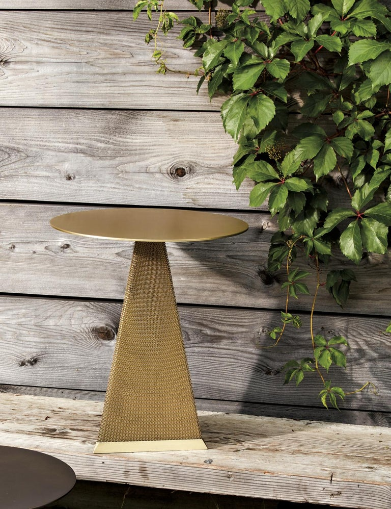 Part of the Armor collection, the Armor side table is inspired by the intricate use of chainmail in medieval armor. This table features a cold-rolled steel table with a triangular base, cloaked in finished stainless steel chainmail. This table is