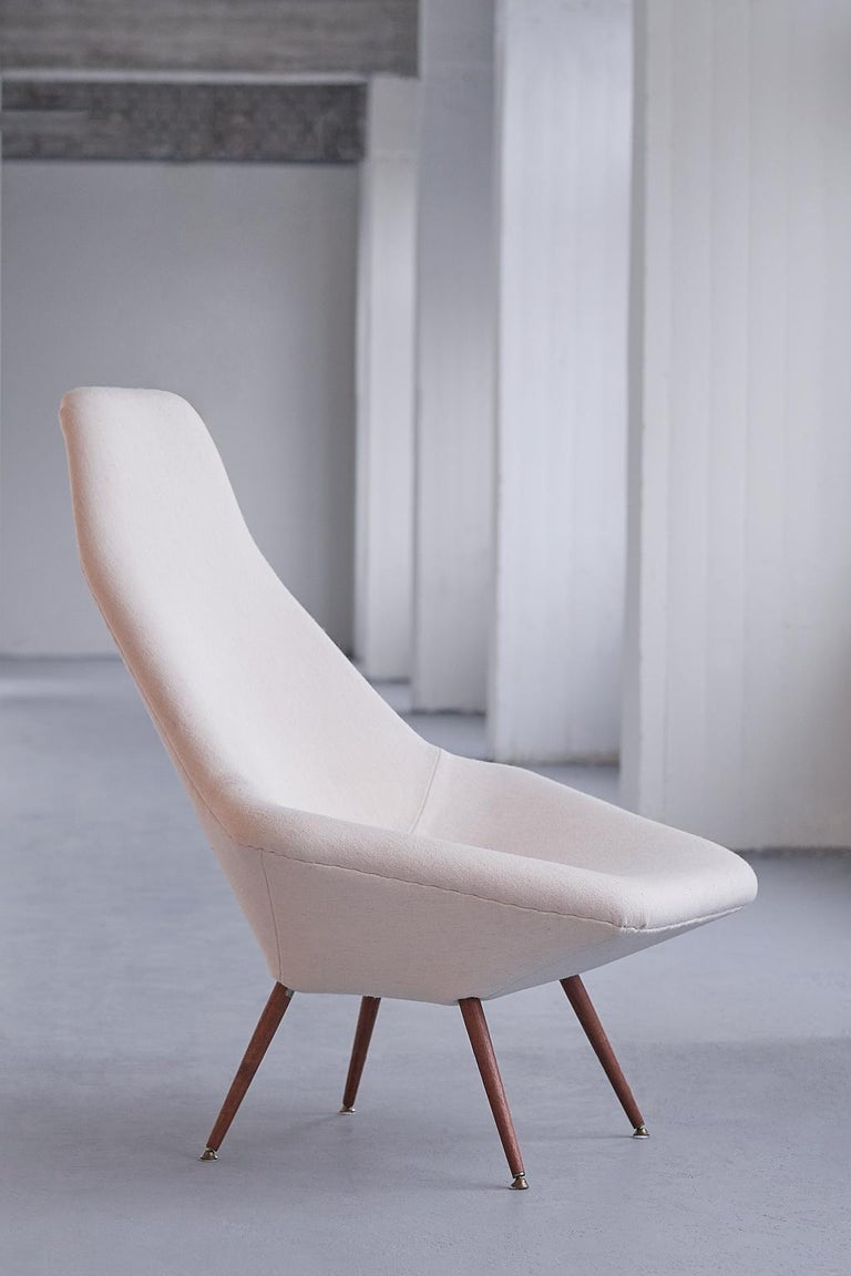 This rare lounge chair was designed by Arne Dahlén in the early 1960s. The design was manufactured by Dahléns Company in the Swedish town Dalum. His company was solely devoted to the production of chairs.  The soft geometric angles give this chair