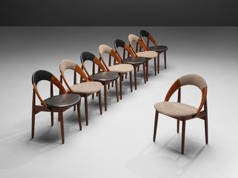 Arne Hovmand-Olsen, bicolor set of dining chairs, teak, wool and leather upholstery, Denmark, 1960s.  Set of dining chairs designed by Arne Hovmand-Olsen. The chairs have a very simple and organic design. The rounded back goes in one flowing motion