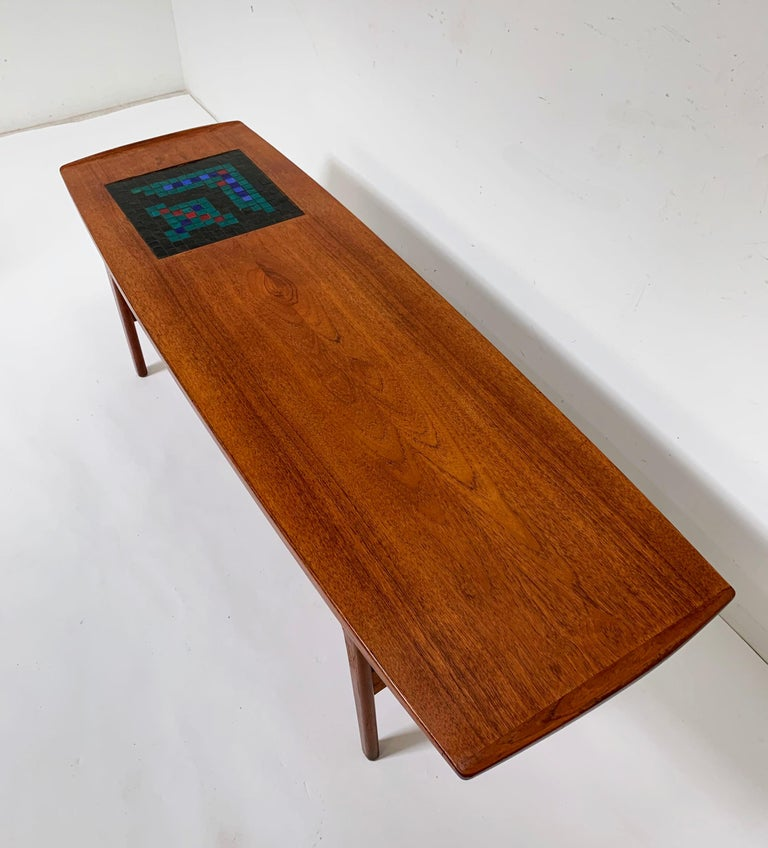 Classic Danish modern coffee table designed by Arne Hovmand-Olsen and produced by Mogens Kold, circa 1957. It is relatively rare to find examples of this model in the United States. Features a glass mosaic panel on top with a freshly rewoven cane