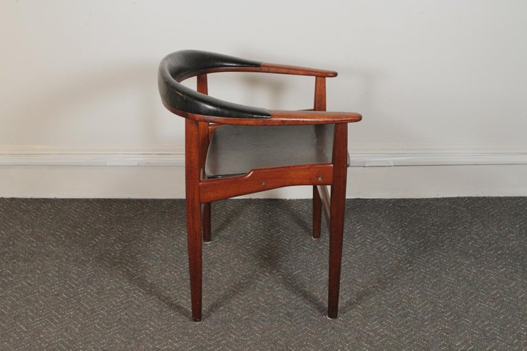 Arne Hovmand-Olsen for Jutex, DK, circa 1957 (Teak + original leather) the rounded back with leather upholstery. The leather is original showing signs of use and the frame is in excellent condition. The chair is signed on the underside of the