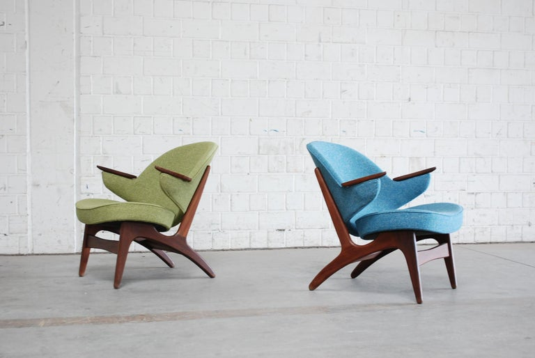 A pair of easy chairs in petrol and green design by Arne Hovmand Olsen in Afromosia wood. The Chair was completely restored and upholstered new in 2 different colours. The fabric is made of a high quality hemp fabric. Great Danish design with an