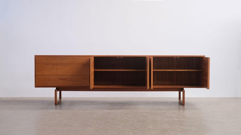 Rare and wonderful low sideboard in teak designed by Arne Hovmand Olsen for Mogens Kold, Denmark. Superb minimalistic design with clean, simple details and super elegant proportions. Beautiful original condition.