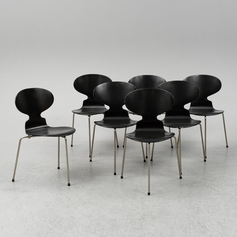 Early pieces of the iconic 'Ant' chairs designed by Arne Jacobsen in 1952. Stackable three-legged dining chairs model 3100 made by Fritz Hansen in Denmark. This set was produced in beginning of 1950s. Black lacquered bentwood on steel frame.