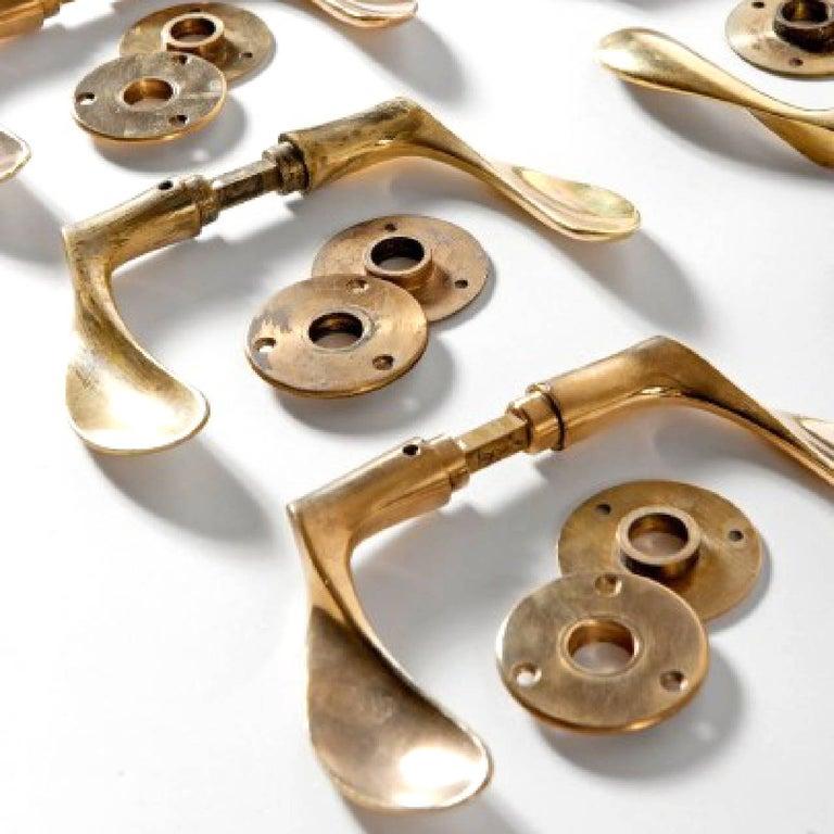 Beautiful and sculptural sets of solid brass door handles brass door handles (9.7cm) by Arne Jacobsen.  Designed for SAS Royal Hotel in Copenhagen which was built by Jacobsen between 1956 and 1960.  Literature: M. Sheridan, Room 606: The SAS