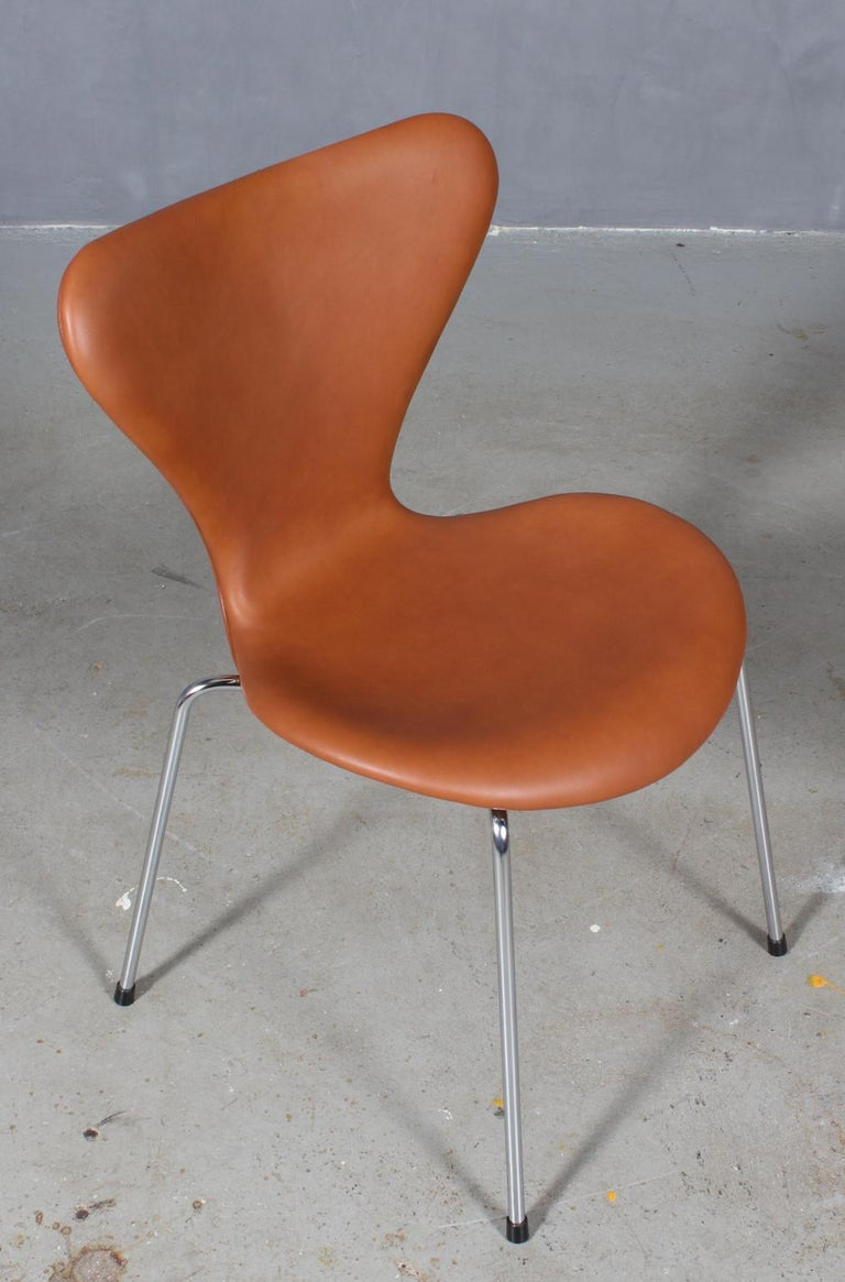 Arne Jacobsen dining chair new upholstered with cognac pure aniline leather.