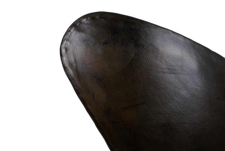 Arne Jacobsen, early egg chair in original patinated black leather. From the first production with built up seat and no cushion, stamped FH in the leather.  Excellent condition with no cracks or holes to the leather.  Literature: Arne Jacobsen,