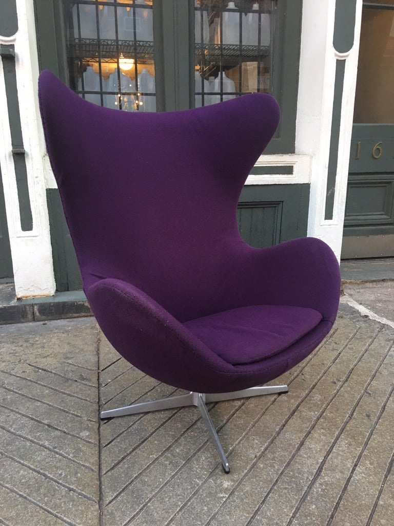Arne Jacobsen purple egg chair. Chair has older purple fabric that is still usable, but shows wear. We can offer upholstery services for the chair. Retains original labels and is dated 1972. Classic Danish chair!