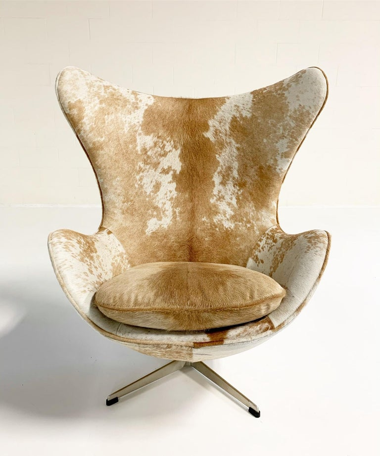 Mid-Century Modern Arne Jacobsen Egg Chairs and Ottoman in Brazilian Cowhide