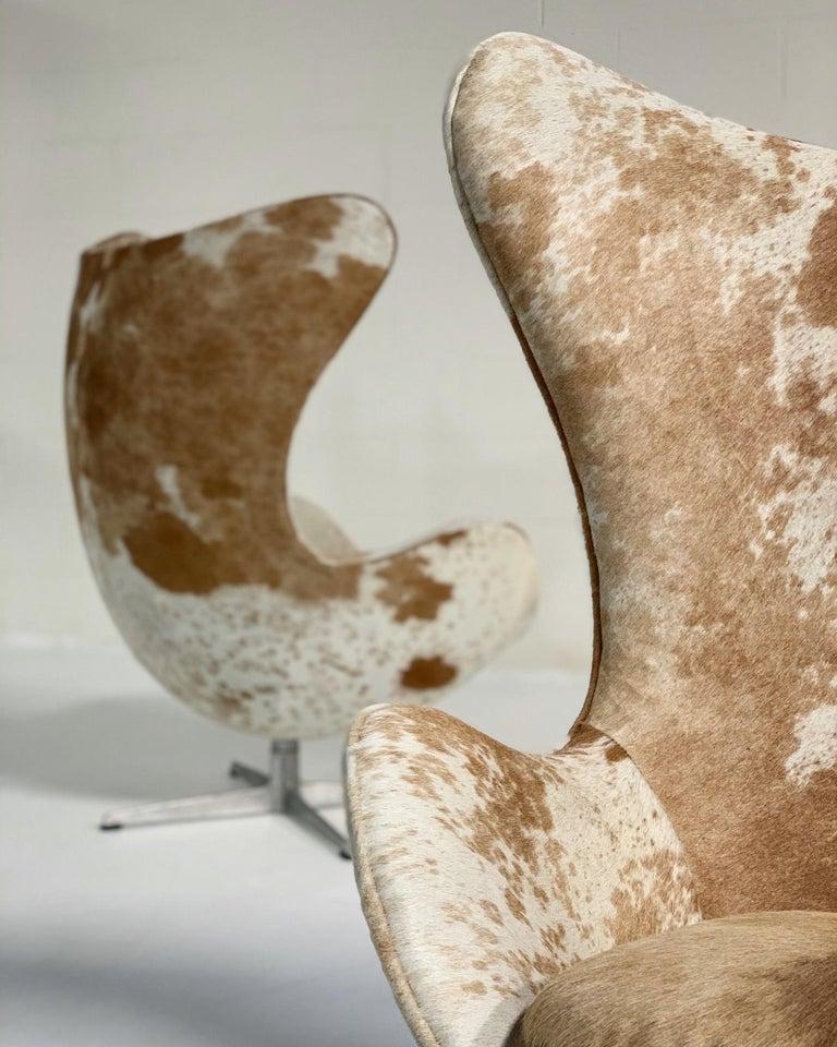 Danish Arne Jacobsen Egg Chairs and Ottoman in Brazilian Cowhide