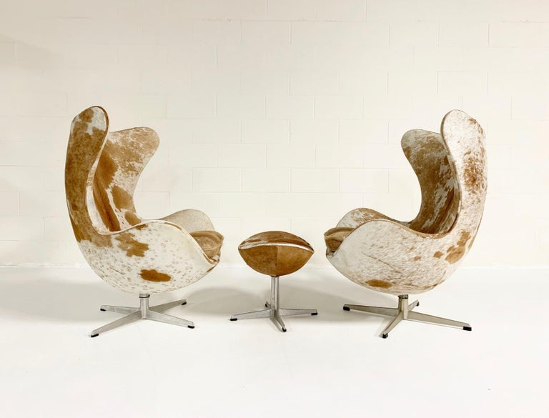 20th Century Arne Jacobsen Egg Chairs and Ottoman in Brazilian Cowhide