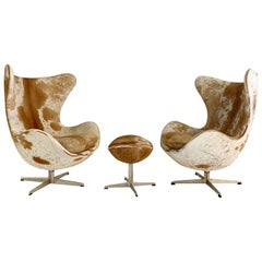Arne Jacobsen Egg Chairs and Ottoman in Brazilian Cowhide